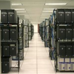 file server aisle showing the servers in various rows of racks